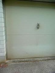 Remplacement d'une porte de garage par une baie vitrée pvc avec fenêtre  ouvrante